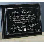 Engraved black plaque with floating glass